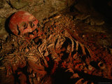 The Cinnabar-Covered Remains of a Maya Woman in the Ruins of Copan Photographic Print by Kenneth Garrett