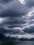 Storm Clouds Hover Above a Mountain Lake in Guatemala Photographic Print by Raul Touzon