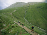 A Team of Hikers Climb Scotlands Ben Nevis Peak Photographic Print by Joel Sartore