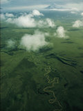 A River Snakes Across the Tundra Toward Distant Mount Shishaldin Photographic Print by Thomas J. Abercrombie