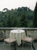 Cafe Table and Chairs Overlooking a Villa on a Hill Photographic Print by Todd Gipstein