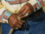 The Hands of a Navajo Elder Wearing Turquoise Rings Photographic Print by David Edwards