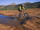 Cyclist Going Through Puddle, Arizona Photographic Print by David Edwards