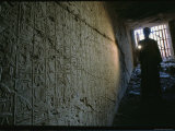 A Man Illuminates a Relief at the Entrance to Ramses Iis Tomb Photographic Print by O. Louis Mazzatenta