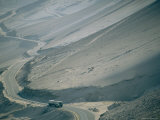 A Truck Traveling on a Road Through the Desolate Atacama Desert Photographic Print by Joel Sartore