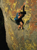A Rock Climber Solo Climbs in Montanas Hyalite Canyon Photographic Print by Gordon Wiltsie