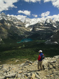 A Hiker Enjoys the View of Obabin Prospect in Yoho National Park Photographic Print by Michael Melford