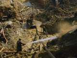 Gold Miners Blast Muddy Holes in the Earth with Water Photographic Print by Steve Winter