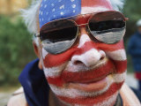 An American Flag is Painted on Mans Face in Arizona Photographie par David Edwards