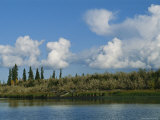 White Clouds Form Above the Mackenzie River Delta Photographic Print by Raymond Gehman