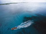 A Skiff Crosses Kantons Lagoon on a Survey of Phoenix Islands Photographic Print by Paul Nicklen
