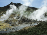 Steam Rising from Geothermal Springs in Kamchatkas Volcanic Region Photographic Print by Klaus Nigge