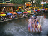The Blur of a Passing Tourist Boat Along the Colorful Riverwalk Photographic Print by Stephen St. John