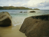 Smooth Rocks Lie on a Beach in the Seychelles Photographic Print by Bill Curtsinger
