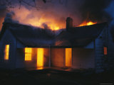 A House is Engulfed in Flames in a Firefighting Exercise Photographic Print by Stephen Alvarez