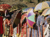 Brightly Colored Umbrellas and Robes Liven an Epiphany Procession Photographic Print by Michael S. Lewis