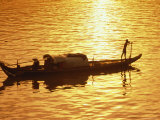 Long-Tailed Boat on the Chao Phraya River at Sunset Photographic Print by Richard Nowitz