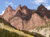 Sunlight Shines on the Peaks of the Rocky Mountains Photographic Print by Charles Kogod