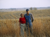 A Smiling Couple Pose in a Cornfield Photographic Print by Joel Sartore
