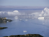 Icebergs from the Ilulissat Glacier Float by a Fishing Village Photographic Print by Sisse Brimberg