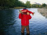 A Fisherman Displays His Sockeye Salmon Catch Fotoprint van Joel Sartore