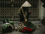 A Woman in a Conical Hat with Bundles of Flowers and Roses to be Sold Photographic Print