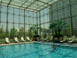 A Father and Child Enjoy the Indoor Pool at the St. Regis Hotel Photographic Print by Richard Nowitz