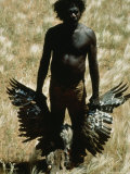 An Aborigine Displays a Wild Turkey He Shot in the Great Sandy Desert Near Yagga Yagga Photographic Print by Sam Abell