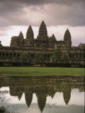 Angkor Wat Temple Reflected on the Surface of a Pool of Water Photographic Print by Richard Nowitz