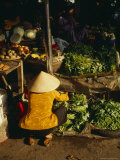 A Vegtable Seller Wearing a Conical Hat in the Wet Market of Hoi An Photographic Print