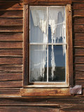 Tattered Curtains Dangle from the Window of an Abandoned Building Photographic Print by Charles Kogod