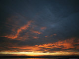 Dramatic Sunset under a Cloud-Filled Sky Photographic Print by Klaus Nigge