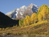 The Majestic Maroon Bells Loom Above Maroon Lake Photographic Print by Charles Kogod