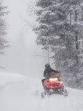A Woman Speeds Along on a Snowmobile in a Blizzard Photographic Print by Taylor S. Kennedy