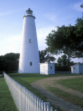 The Lighthouse Stands Behind a Fence on Ocracoke Island Photographie par Stephen Alvarez