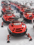 A Large Group of Snowmobiles Sit Waiting for Action Photographic Print by Taylor S. Kennedy