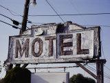 A Neon and Plywood Motel Sign Shows its Age Lámina fotográfica por John, Stephen St.