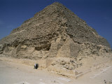 Two American Tourists Reach out to Touch the Ancient Stone of the Step Pyramid Photographic Print by Stephen St. John