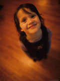 A Little Girl Looks up and Smiles Photographic Print by Stephen Alvarez
