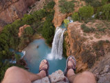 A Look Over a Cliff at a Waterfall Far Below Between Two Feet Photographic Print by Taylor S. Kennedy