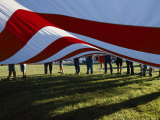 Boy Scouts Lift a Huge American Flag at the Clay County Fair Photographic Print by Randy Olson