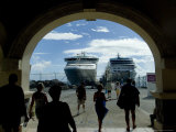 People Walking Through Port Entrance to Two Cruise Ships Photographic Print by Todd Gipstein