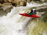 A Kayaker Careens over a Waterfall into the Swirling Whitewater Below Photographic Print by Barry Tessman