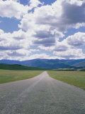 A Country Road and Cumulus Clouds in the Cuyama Valley Photographic Print by Marc Moritsch
