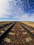 Clouds Hover over Old Railroad Tracks Fotoprint van Nicole Duplaix