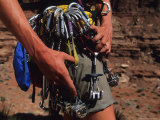 A Rock Climber Check Her Gear Before a Climb Photographic Print by Bill Hatcher