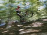 A Boy Flies Through the Air on His Mountain Bike Fotografisk trykk av Roy Gumpel