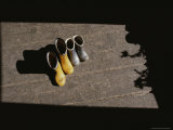 Two Pairs of Boots Sit in Sunlight Coming Through an Open Window Photographic Print by Jodi Cobb