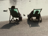 A Couple Relaxes in Lawn Chairs on the Edge of an Artificial Lake Photographic Print by Jodi Cobb