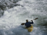 A Kayaker Paddles Through White-Water Rapids on the Snake River Photographic Print by Raymond Gehman